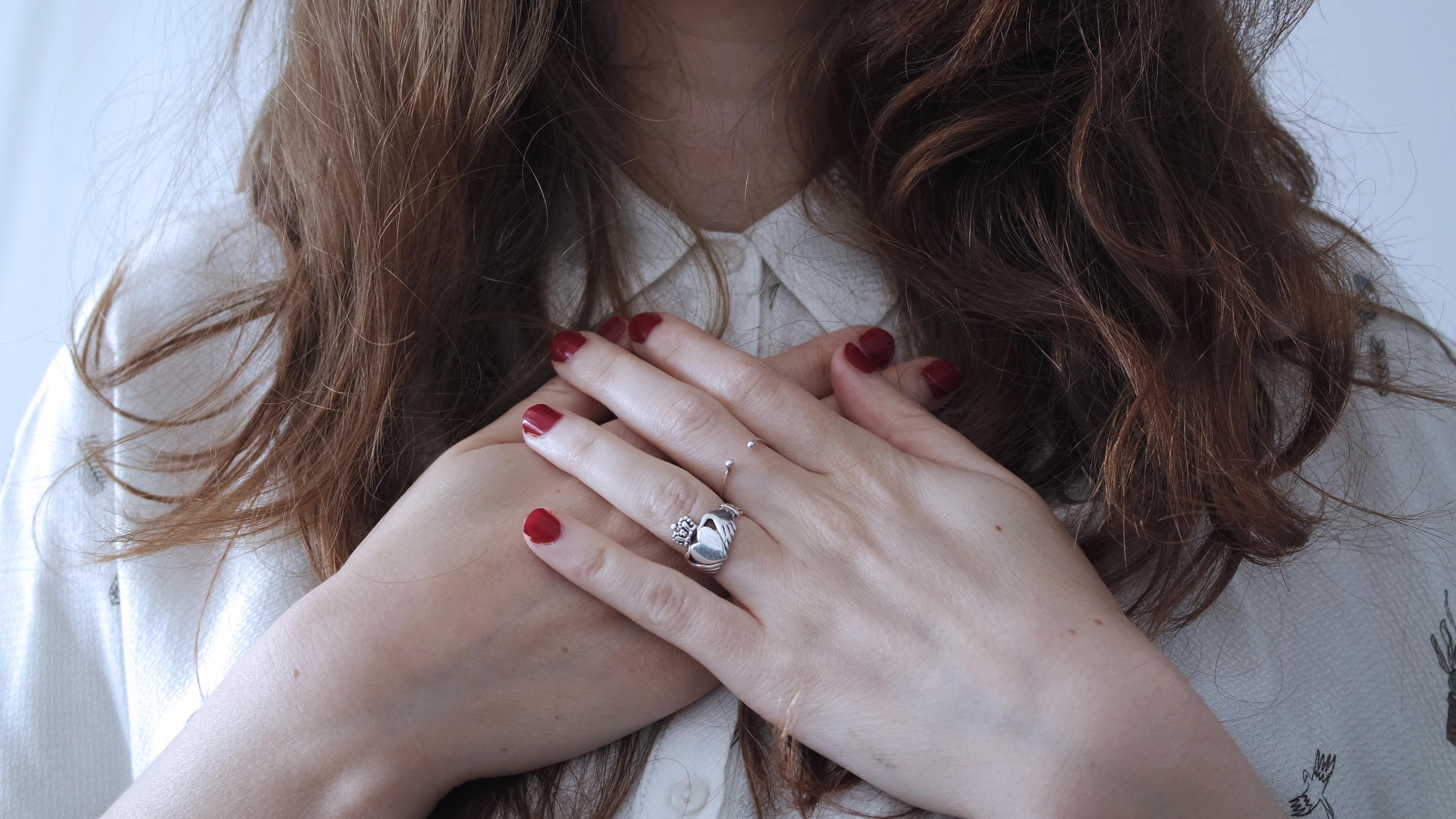 girl hands to heart