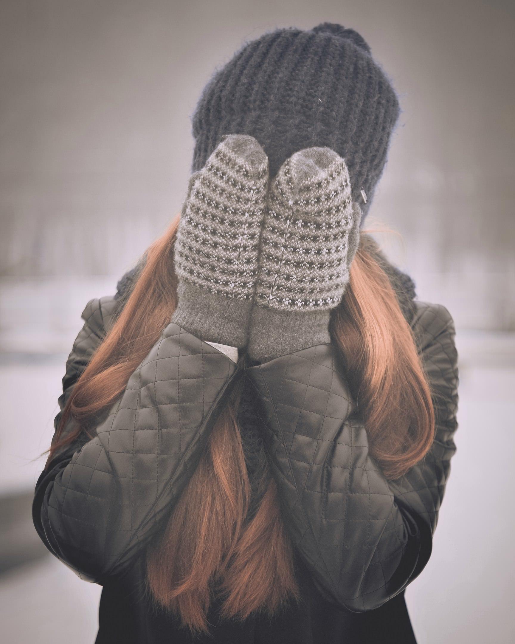 girl-hiding-mittens